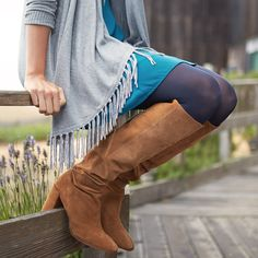 """If you're just dipping your toe into the shallow end of the fringe-trend pool, a knit open-front cardigan with subtle hem embellishment is less """"in your face"""" fringe. Throw this easy layer over a dress with tights & high boots, then add long, lariat pieces to play up the vibe while still remaining in your classic comfort zone."""