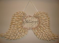 Angel wings paper book pages by RevolvingDoorDecor on Etsy. $60.00, via Etsy.