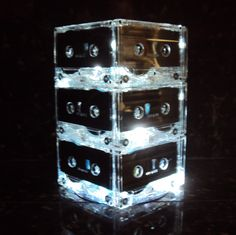 make this centerpieces by gluing together '80s tapes and setting them around battery-operated LED lights