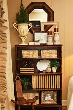 like this shelf vignette - well set up - textures, shapes, books, frame ... etc. all of it.