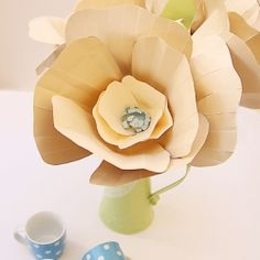 Giant Paper Flowers In tans and cremes look great for fall and transition nicely into your winter decor too!