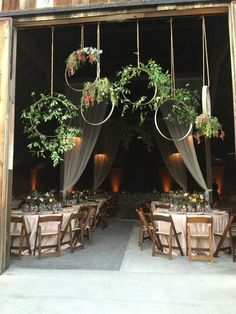 Wine barrel floral hoops that our florist created for the entrance to our barn wedding. Bohemian