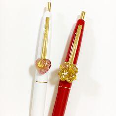 左…ハート型、ムーンストーン入りオルゴナイト。ペン色は白。 右…クローバー型、シトリン入りオルゴナイト。ペン色は赤。