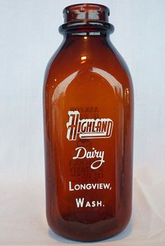 "Vintage Quart Glass Milk Bottle From Highland Dairy Longview, WA    This old brown glass milk bottle is a 1 quart size. It's from the Highland Dairy in Longview, Wash. It measures 8 3/4"" tall x 3 1/4"" x 3 1/4"".    Tin Can Alley    inside the Castle Rock Mercantile Antique Mall  160 H Huntington Avenue N  Castle Rock, WA 98611 www.bagtheweb.com/b/UG8KRi bagtheweb.com/b/E7Kxc0  Vintage Northwest: bagtheweb.com/vintage"