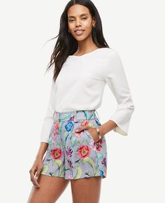 """Make every day a garden party with these flattering pleated shorts, popped in a vivid bouquet of exotic florals. Contoured waistband. Front zip with double hook-and-bar closure. Belt loops. Front pleats. Front off-seam pockets. Back welt pockets. 4 1/2"""" inseam."""