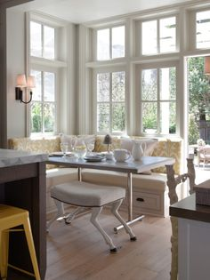 love the idea of a corner banquet like this. beautiful windows