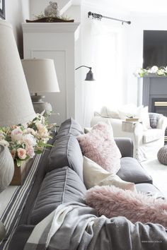 grey sectional with blush pillows