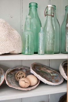 old sea glass colored bottles and shells