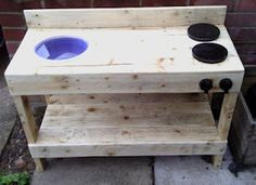 Handmade outdoor play kitchen ...I want this with 4 burners and a stainless steal bowl.....