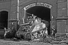 Sherman tank of Company C, Tank Battalion, drives through the entrance of the Aachen-Rothe Erde railroad station in Aachen, Germany on October 1944 Siegfried Line, Operation Market Garden, Sherman Tank, Man Of War, Armored Fighting Vehicle, Story Of The World, Ww2 Tanks, Military Diorama, Panzer