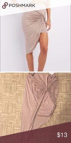 NWT BEIGE / sand grey tie knot skirt New with tags beautiful classy and sexy asymmetrical skirt with tie knot on the side super fun and flirty hugs your curves and is great to wear out! Smoke free home fast shipping! Charlotte Russe Skirts Asymmetrical