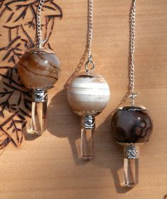 White Magick Alchemy - Agate Gemstone Pendulums for Divination and Dowsing, $19.95 (http://www.whitemagickalchemy.com/agate-gemstone-pendulums-for-divination-and-dowsing/)