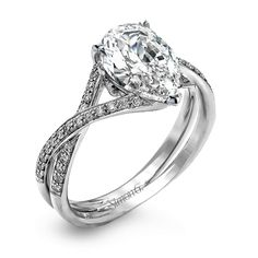This modern engagement ring setting is created for a pear shaped center stone and contains .15 ctw of white diamonds.