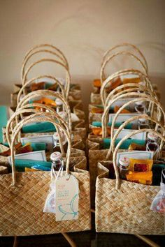 Gifts for the wedding party in a beach bag...