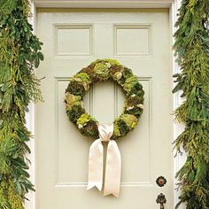 Moss Wreath, cedar garland | Soothing hues and luscious textures set the tone for an elegant holiday. Chartreuse reindeer moss brightens this wreath. | SouthernLiving.com