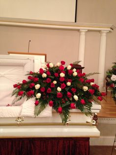 Eula Mae Bass' red and white rose casket spray