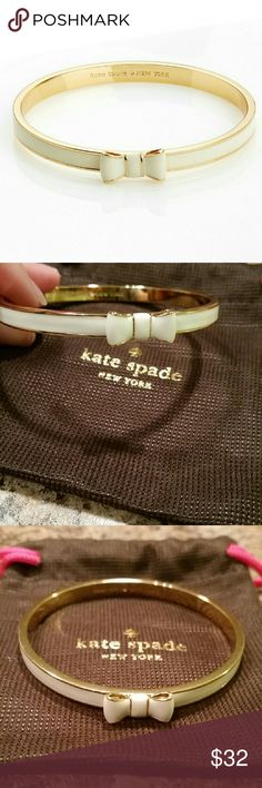 """Kate Spade Take a Bow Bangle. Kate Spade Take a Bow Bangle. It's always a good time to add a little shine! Shiny gold plated material with enamel fill. Inner diameter is 2.5"""" the color is cream and gold. This is a brand new Bangle.   Please let me know if you have any questions or need more pictures.   I can bundle with other items in my listing. I also have two other very cute Kate Spade cuffs.   No trades.   Will include dust bag. kate spade Jewelry Bracelets"""