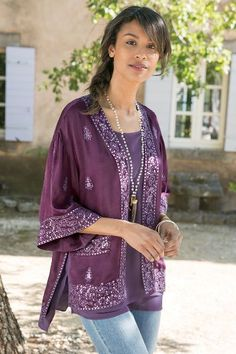 In a royal looking purple, our Karavan Kimono is enticingly exotic. Dropped shoulders and side slits complete the look. It's a faraway look you can wear anytime!