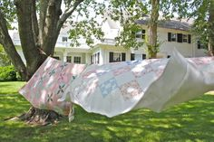 Quilts on the line on a beautiful, breezy day