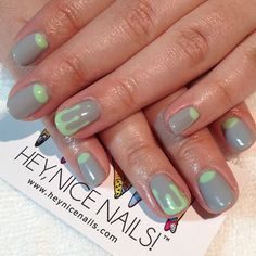 Grey gels with pistachio half moons and drips (at Hey, Nice Nails!)