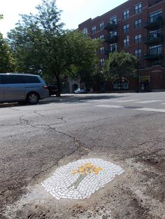 chicago_pothole_flowers_04 - When city ugly faces become something beautiful and artistic!
