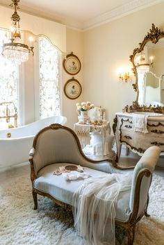 Lustrous gilded accents, a chandelier dripping with crystals, and linens as soft as new-fallen snow cultivate a sense of romance in this opulent master bath.