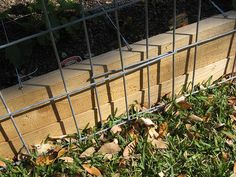anchoring a cattle fence panel trellis