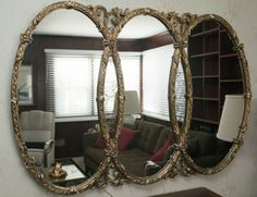 ORNATE ROUND GUILDED MIRROR For more information visit www.CalAuctions.com