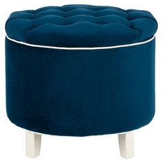 Upholstered storage ottoman with a tufted lid and contrast trim.  Product: Storage ottomanConstruction Material: