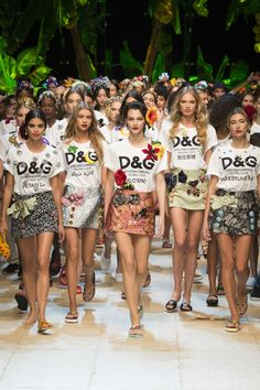 """The finale is always a chance to celebrate the work of the talented designers who put the collections together and at Dolce & Gabbana's show it was no different. The models walked as a mega-collective, made up of several famous faces (including Hailey Baldwin and Taylor Hill), all in matching D&G t-shirts that poked fun at cheap knock-offs and ultra-mini mini-skirts adorned with shimmering bows."" - Wonderland"