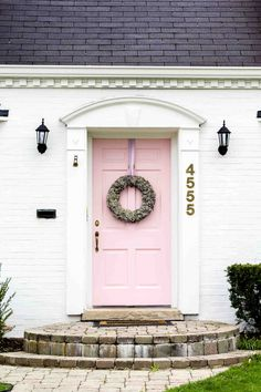 I'm a bit fan of front doors that are smart and elegant and set the tone for the interior. You would never tire of coming home to this pretty pink one...