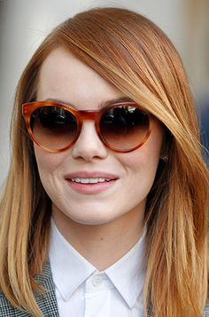 Emma Stone making a statement with these red #sunnies