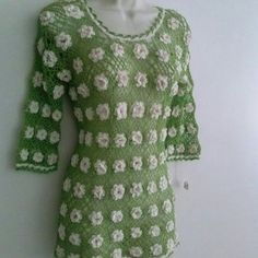 Vintage hippy green flower CROCHET TOP tunic Crochet top tunic sweater In amazing condition. Pure real vintage hippy flower power 70's 80's crochet green knit 3/4 sleeves with flowers. Gorgeous piece. If you have any questions please tag me.  Measurements: shoulder to bottom 27 inches Arm to arm about 19 inches  Mid section: 13 inches Bottom is 16 1/2 inches Vintage Tops Tunics