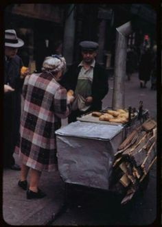 1942 Hot Potato/Spud Vendor E. 7th St. between 2nd and Third Aves.  During the height of the Depression they cost 5 cents.  On a personal note, my mother would rave about these, a great childhood memory for her. nystreetfood.com