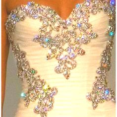 I want my wedding dress to have rhinestones on it and have lace:)