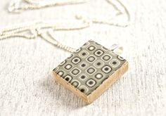 You dont have to dress up for this modern art pendant ~ it loves everything!