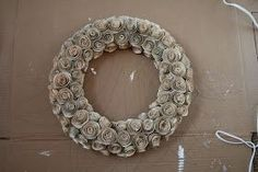 HOW TO MAKE A BOOK PAGE ROSE WREATH    First you need to make the roses. For the how to  click here.    The size of your wreath will determ...