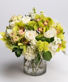 Serenity A soft and serene collection of all whites, creams and greens including seasonal favorites like hydrangea, orchids, are roses is designed in our signature glass cylinder vase.