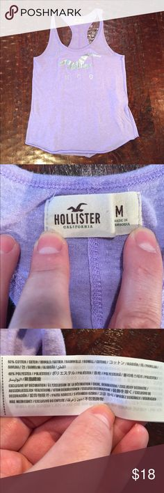 "🌼 Hollister Logo Racerback Tank Top Medium Hollister Logo Racerback Tank Top. Tank is 23 1/2"" from shoulder to hem. Bust measures 15"" laying flat. Tank is in excellent condition, with no signs of wear. Comes from a Smoke Free/Pet Friendly home. Offers always welcome. Hollister Tops Tank Tops"