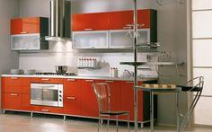 beautiful modern kitchen with orange high gloss finish
