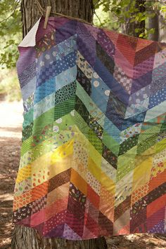 amylewwho:  Rainbow Zig Zag Cheater Quilt by Weaving Major by Spoonflower Fabrics on Flickr.