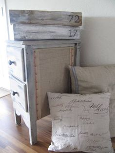 The burlap went on the outside of the nightstand!  So cute, I love the whole effect.  Tutorial too!
