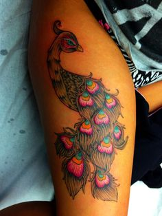My finished peacock tattoo. Thigh piece . Love! Peacock tattoo . Thigh peacock tattoo . Colour tattoo .