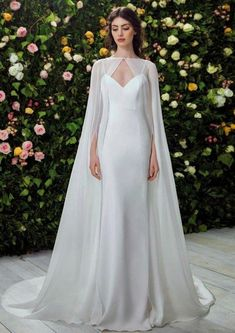 The wedding dress is filled with delicately feminine details. Which is irresistibly romantic bridal collection features elegant wedding dresses. Click the picture to see more beautiful dresses. Muslim Wedding Dresses, Bridal Dresses, Wedding Gowns, Wedding Dress Cape, Snow White Wedding Dress, 2017 Wedding, Cape Dress, Wedding Trends, Wedding Ideas
