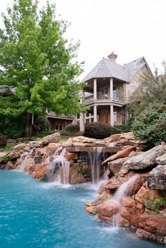 Natural Stone borders this pool creating a dynamic water feature and oasis in this home's backyard.  Old Gate, Plano TX