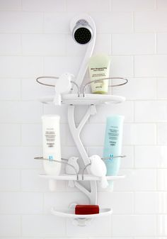Cute shower storage caddy with lots of space, wholes to place shampoo bottles, and even a place to hold razors.