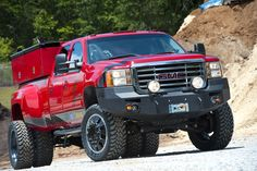 Red dualie GMC Sierra commercial vehicle lifted