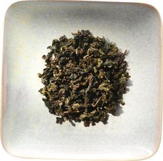 Emerald Goddess brews up a golden yellow cup and possesses a wonderful sweet and creamy aroma. Its flavor is similarly soft and smooth, with a full body and lingering roasted flavor. This tea holds up well to a second and third infusion. Emerald Goddess will retain its unique flavor, making it perfect for all-day sipping.This tea's unique appearance is created by a heavy rolling process. The lightly oxidized leaves are rolled into tightly curled balls that unfold during infusion to yield…