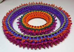 Bangle bracelet with 11º and 15º seed beads using Right Angle Weave as the base with picots for embellishments.