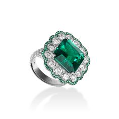 Haute Couture ring in 18k white gold with one octagonal cut emerald, emeralds and diamonds by Adler